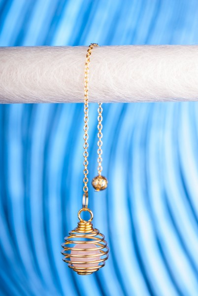 Spiralpendel mit Rosenquarz,vergoldet